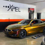 BMW metallic vinyl wrap color change - Xpel: Gloss Rising Sunred/Gold